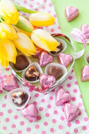 confiserie: Colorful Chocolates in heart shaped chocolate box Stock Photo