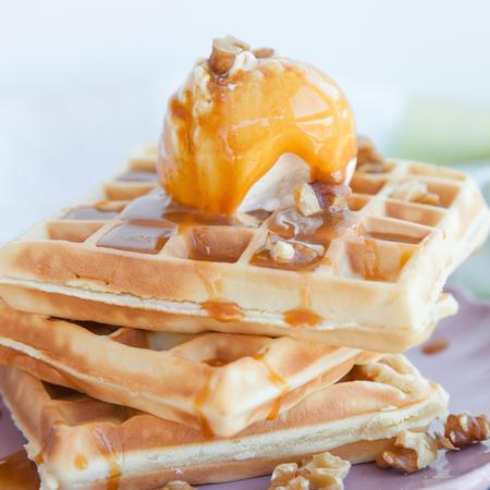 caramel sauce: Waffles with ice cream, caramel sauce and walnuts Stock Photo