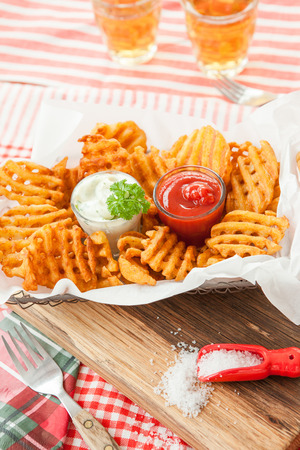 side order: Fresh waffle fries with ketchup and mayonnaise