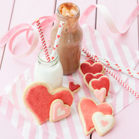 Pink cookies and milk in a vintage bottle