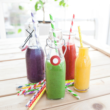 oj: Variety of fresh smoothies in rainbow colors