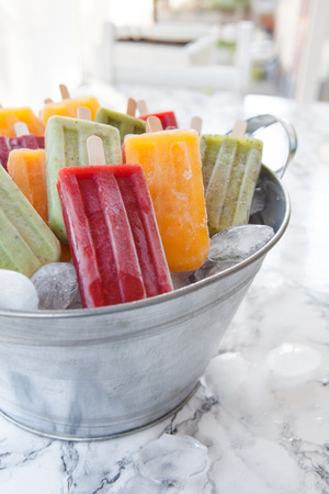 flavors: Homemade frozen ice cream popsicles in various flavors Stock Photo