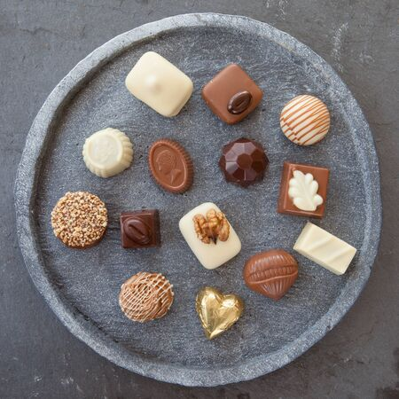 confiserie: Fine selection of yummy chocolates and truffles Stock Photo