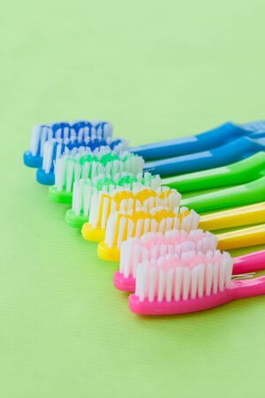 prophylaxis: Colorful tooth brushes in bright neon colors