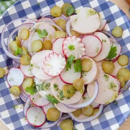pork sausage: Bavarian pork sausage salad with radish and cornichons