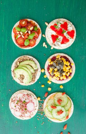 spreads: Round rice cakes with various bread spreads and fresh veggies