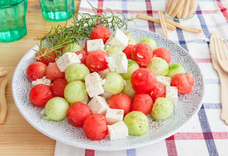 fruity salad: Cucumber salad with feta and water melon balls Stock Photo