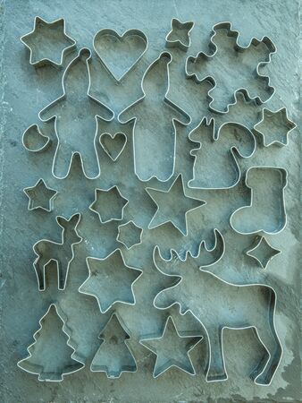 cutters: Rustic christmas background with vintage cookie cutters