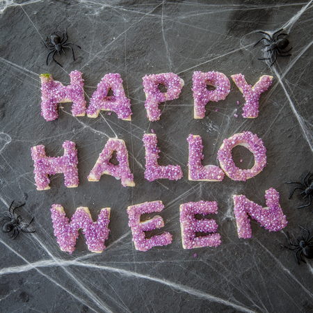 Happy Halloween banner made from cookies with purple sugar sprinkles Stock Photo
