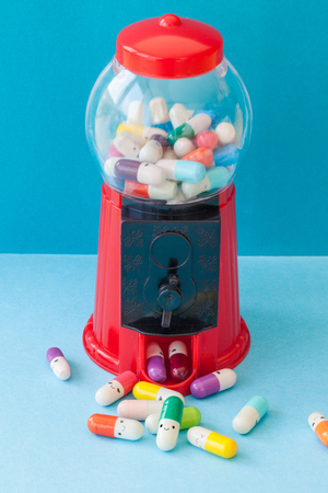 Colorful pills with happy faces, mental health concept