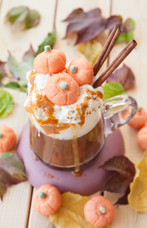 Pumpkin spice latte with whipped cream and marshmallows