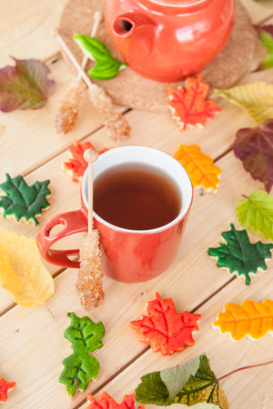 Hot tea and colorful cookies in fall