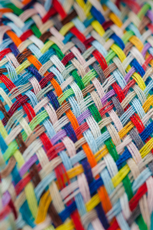 loosely: Colorful cotton yarns woven loosely into a pattern