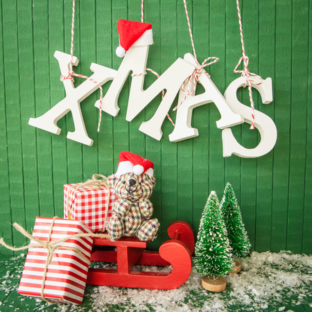 Little christmas presents and XMAS in wooden letters Stock Photo