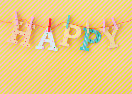 Colorful HAPPY banner on background with stripes Stock Photo