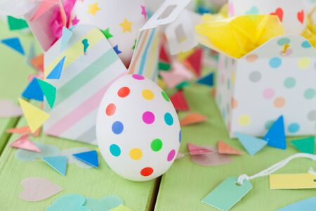 Easter eggs with colorful stickers in little gift boxes stock easter eggs with colorful stickers in little gift boxes photo negle Gallery