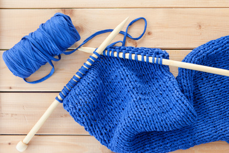 Knitting With Big Needles And Blue Yarn Stock Photo Picture And