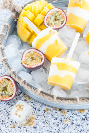 paletas de hielo: Homemade frozen popsicles with fresh mango and passion fruit