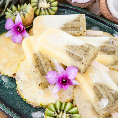 lolli: Homemade frozen ice cream popsicles with pineapple