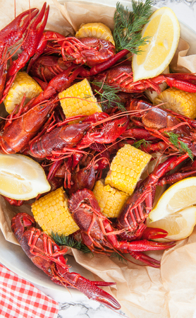 Boiled crawfish with dill and fresh lemon