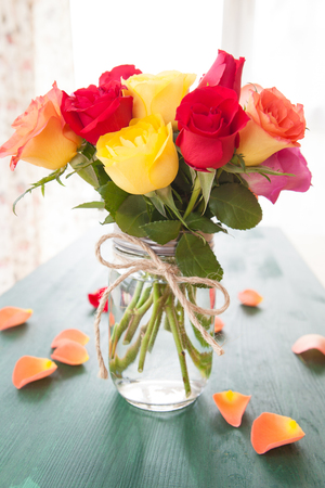 Bouquet of fresh roses in bright colors