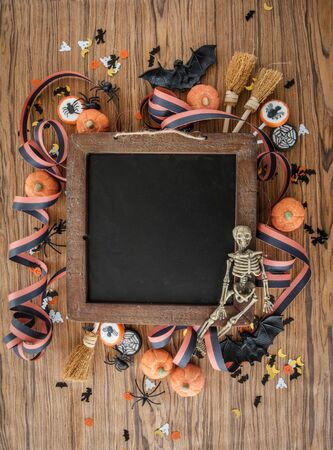 Colorful Halloween background with decorations and candy Stock Photo