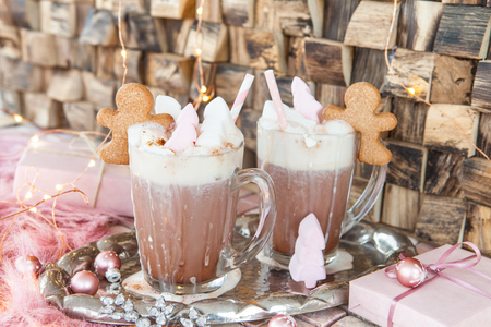 Hot chocolate in glass mug with whipped cream