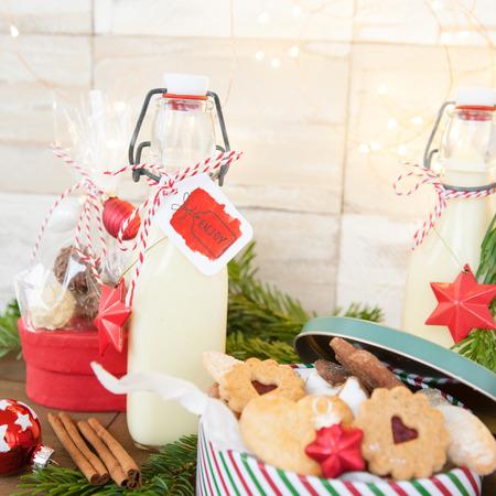 Homemade egg nog in vintage bottle with christmas decorations
