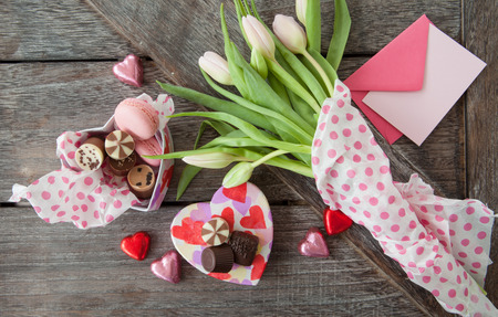 Fresh tulips and a heart box full of chocolates