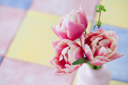 Bunch of pink tulips in a little vase