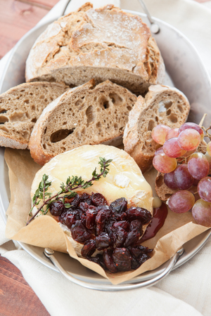 Baked brie with cranberries and fresh rye bread