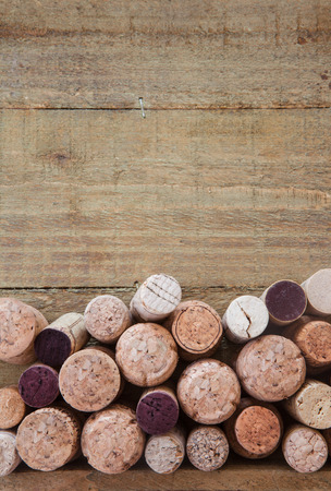 Variety of wine and champagne corks on a wooden background