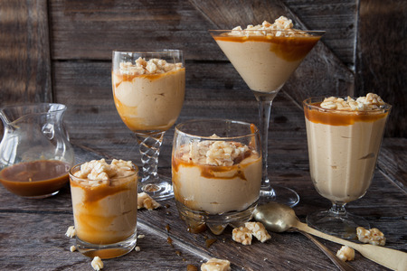 Delicious caramel mousse with butterscotch and peanut brittle 스톡 콘텐츠 - 106238191