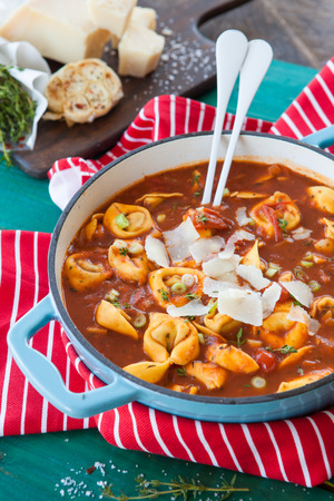 Delicious tortellini in a tomato sauce / soup in a pan
