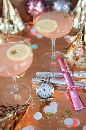 Colorful props for a festive New Years Party 2018 / 2019 with a pocket watch showing midnight Stock Photo