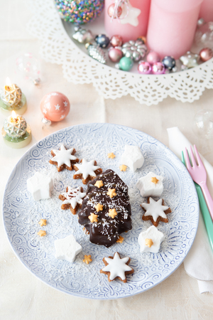 Chocolate covered ice cream in a Christmas tree shape with coconut Stok Fotoğraf