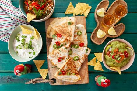 Delicious homemade quesadillas with fresh guacamole and tomato salsa