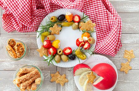 Colorful antipasti, cheese and savoury crackers for Christmas