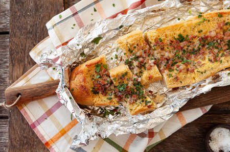 Crispy baguette with egg and bacon bits
