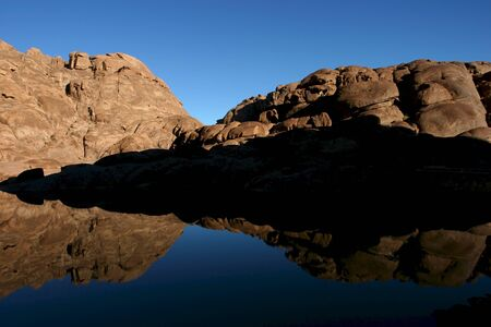 bible ten commandments: Wonderful lake in the desert of Sinai with sunrise with blue water and reflections
