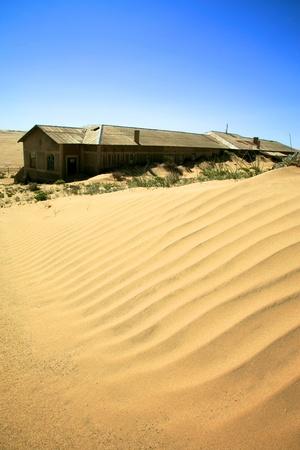 The Ghost city in Kolmanskop - Luderitz in Namibia. Stock Photo - 11470748