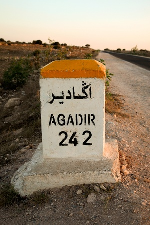 Sign road with the distance left to drive to reach Agadir at 242 km.