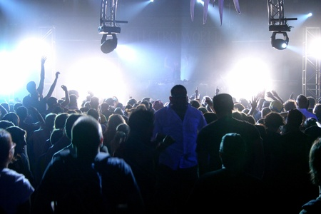 People jumping and dancing during a live concert