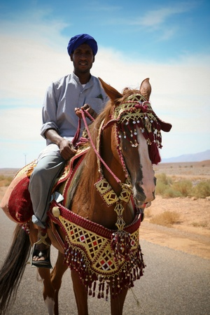 Moroccan riders on the road to marrakech close to the city of Tata in Morocco Editorial