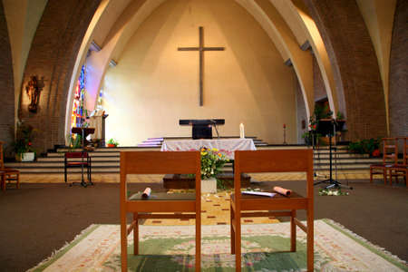 catholic wedding: European church. Two chairs before the wedding, Belgium.