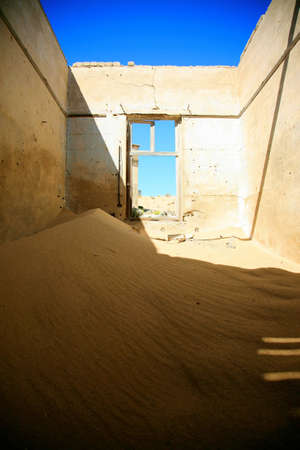 A small sand dune formed in an old derelict house in Kolmanskop, Namibia.