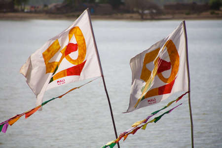 independance: Mali flags floating with the Delta of Niger behind. For the 50th anniversary of its independance
