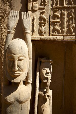 African Dogons sculptures in Mali made in wood photo