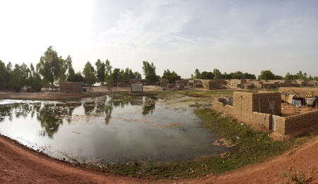 Panorama of a flooded village close to Mopti in Mali with traditional architecture and lifestyle photo
