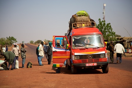 Over loaded mini van on the roads of Mali waiting for passengers Editorial